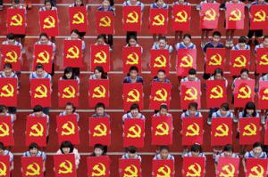 Chinese Middle-schoolers held emblems of the Communist Party of China in Suining, Sichuan province, during a ceremony. China Daily/Reuters/File