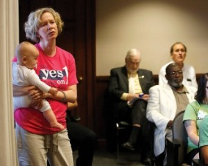"Doug Strickland/Chattanooga Times Free Press/AP REOPENING THE DEBATE: Wendi Morgan (left) wears a ""Yes on 1"" T-shirt as she holds her daughter at a Hamilton County Commission meeting in Chattanooga, Tenn. The commission voted to pass a resolution in support of Amendment 1."